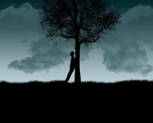 Hình ảnh đầy cô đơn của chàng trai dưới bóng cây
